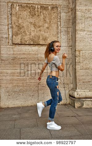 Hipster Girl Listening To Music With Headphones And Dancing.