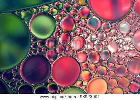 Oil drops on water surface, abstract macro background.