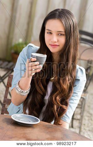 Beautiful young maori woman drinking coffee