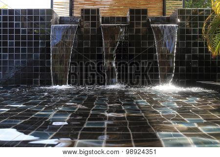 Flowing Water Decorated In Swimming Pool