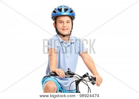 Little boy with blue helmet sitting on his bicycle and looking at the camera isolated on white background