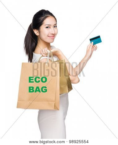 Happy shopping woman credit card and shopping bag for showing eco bag