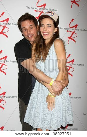 LOS ANGELES - AUG 15:  Christian LeBlanc, Amelia Heinle at the
