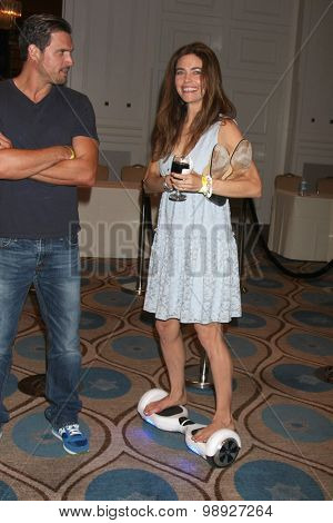 LOS ANGELES - AUG 15:  Joshua Morrow, Amelia Heinle at the