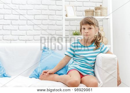 indoor portrait of young happy smiing child girl at home