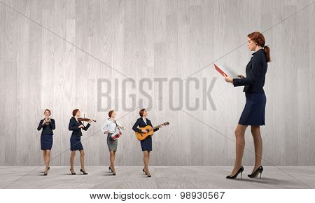 Young woman with book and playing different music instruments