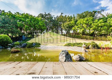 Wood Floor On Pond And Water Landscape In Japanese Garden