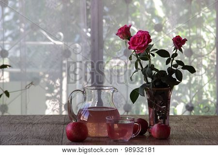 Compote From Fresh Apples In A Jug And A Bouquet Of Roses