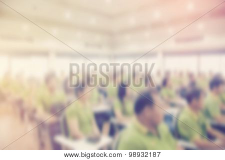 Abstract Blurred People In Seminar Room With Vintage Effect.