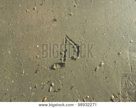 Picture of eight note on sand beach