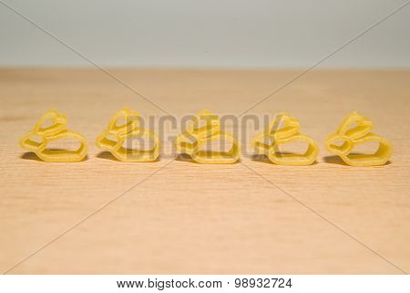 Pasta In The Form Of Rabbits On A Wooden Surface