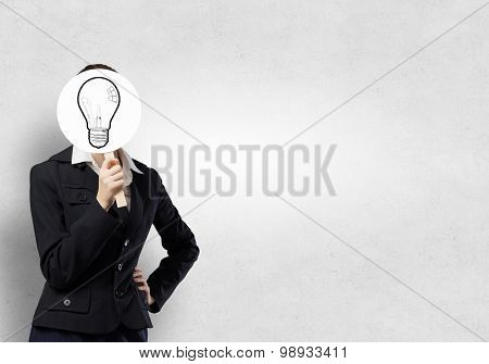 Unrecognizable businesswoman hiding her face behind bulb shaped mask
