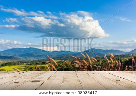 Abstract Blurred And Wood Table, Beautiful Mountains Landscape In Thailand.