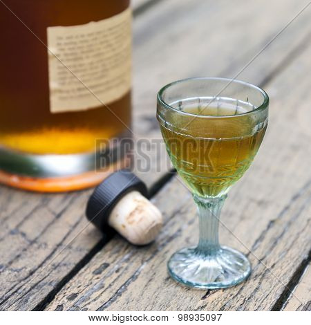 Vintage brandy glass with bottle and cork