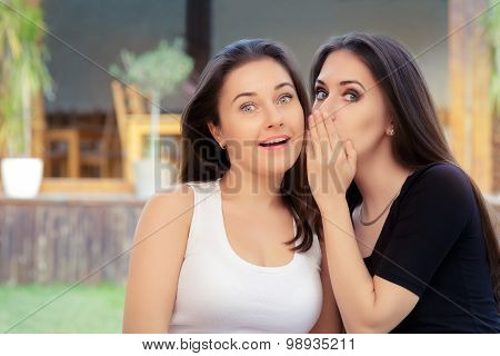 Two Best Friend Girls Whispering a Secret