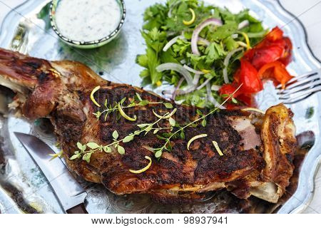 Roast shoulder of lamb with herbs