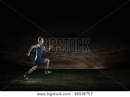 Young running man athlete in blue wear