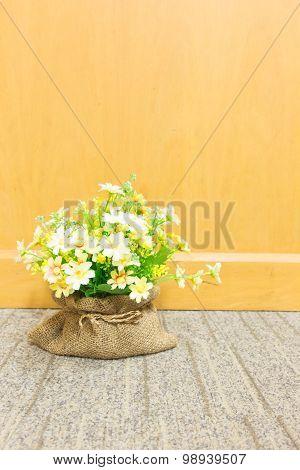 Flowers In Brown Sack