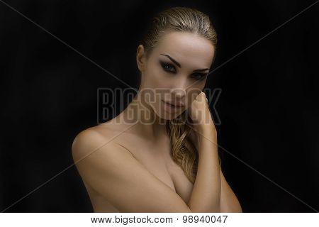 Beautiful Sexy Blond Woman. Dark Background. Bright Smokey Eyes Makeup And Styled Hair