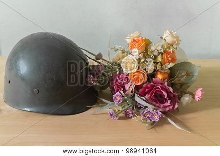 army helmet and flower