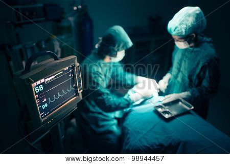 Surgeons team working with Monitoring of patient in surgical operating room.