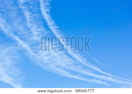 Blue Sky With White Condensation Trails