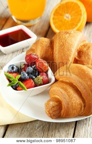 Fresh Tasty Croissants With Berries On Grey Wooden Background