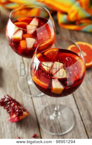 Glasses Of Sandria On Grey Wooden Background