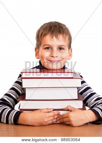Schoolboy And A Heap Of Books