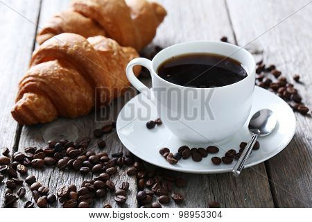 Delicious Croissants With Cup Of Coffee On Grey Wooden Background