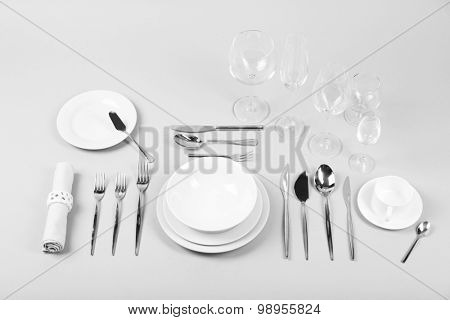 Table setting, close up, on grey background