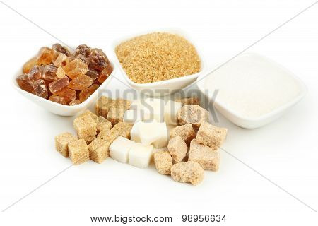 Various Kinds Of Sugar In Bowls Isolated On White