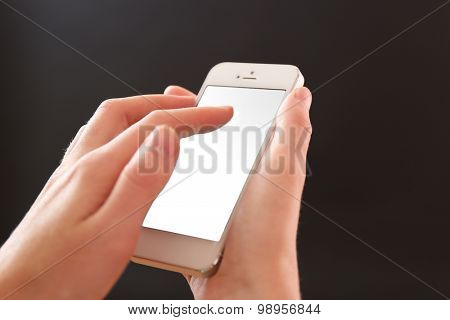 Finger touch number on smartphone to make a call on black background