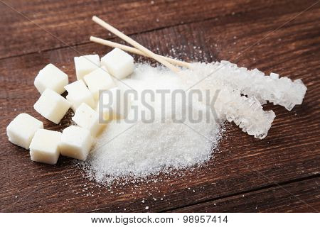 White Sugar On Brown Wooden Background