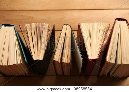 Heart of books, on wooden background