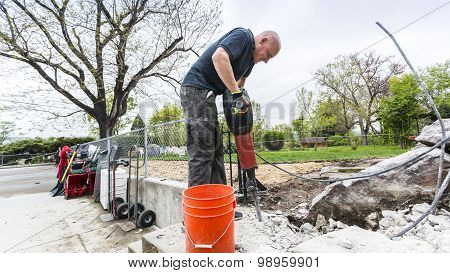 Strong Man Using Jackhammer