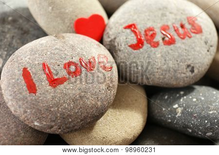 Pebbles with inscription I LOVE JESUS, closeup