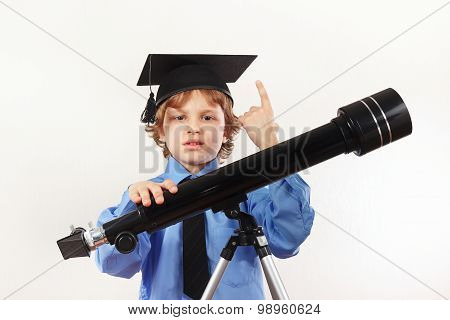 Little professor in academic hat with old telescope on white background