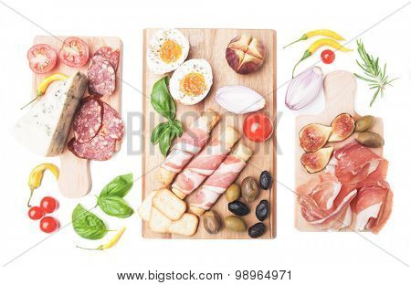 Prosciutto di Parma with olives and other italian antipasto food isolated on white background