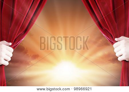 Close up of hand opening red curtain