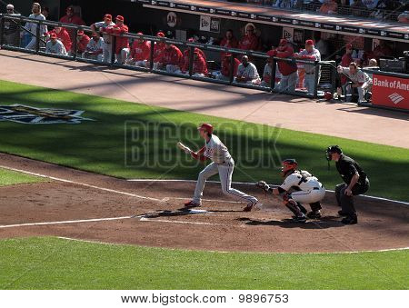 Batter Cole Hamels Set To Bunt With Buster Posey Catching