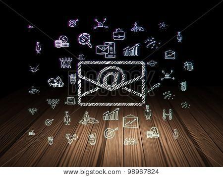 Business concept: Email in grunge dark room
