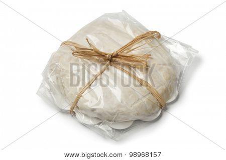 Soft Italian Tuma dla Paja cheese on white background