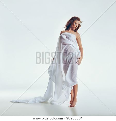 Sensual Model Wrapped In White Cloth