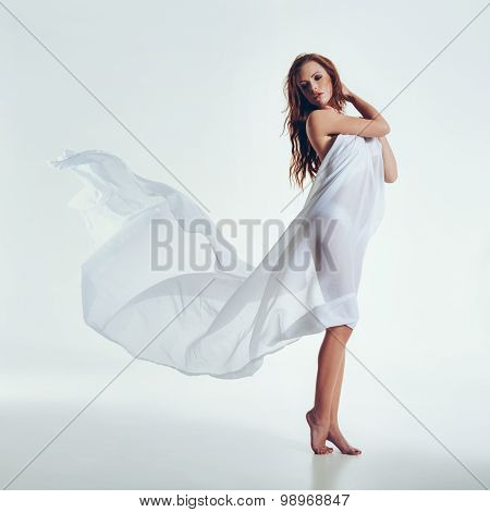 Sexy Woman With Flying Textile In The Studio