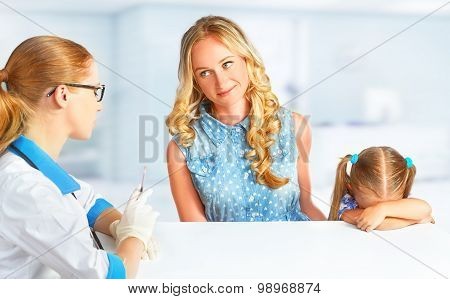 Child With Her Mother On Visit At Doctor Afraid Vaccinations
