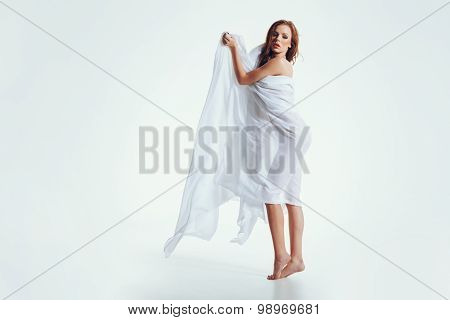 Naked Woman Posing Sensuously On White Background
