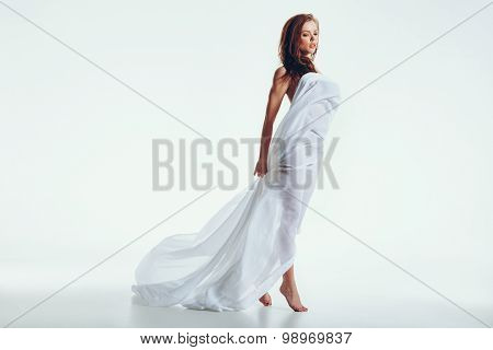 Attractive Nude Woman With A White Fabric On Her Body