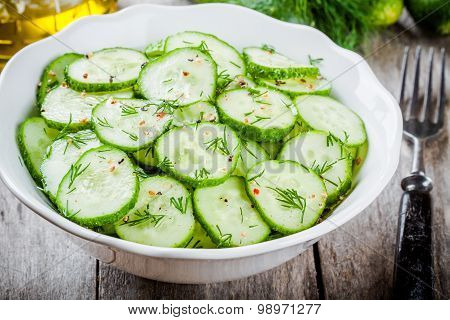 Salad With Fresh Organic Cucumbers And Dill With Olive Oil Closeup