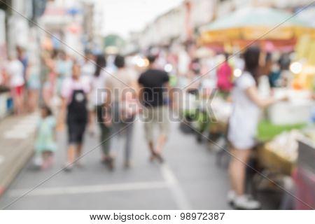 Blurred People Walking On The Street